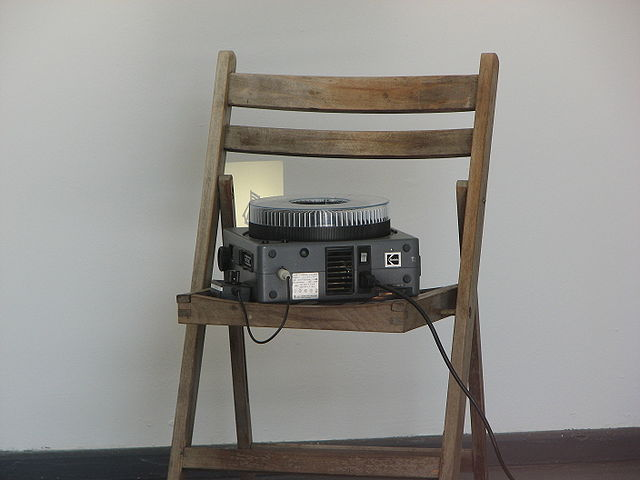 Slide projector on a wooden chair